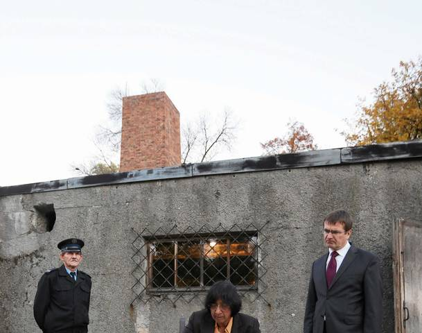 U.N. High Commissioner for Human Rights Pillay signs a visitor book at Auschwitz camp in Oswiecim